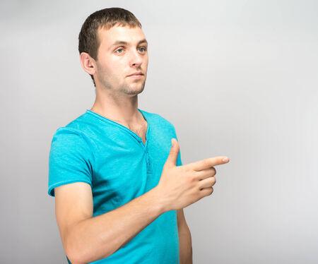 집게 손가락: young successful businessman clicks forefinger 스톡 사진