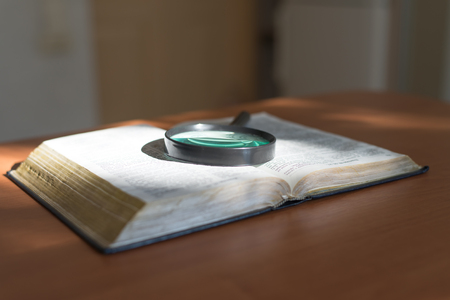 Book and glass loupe photo