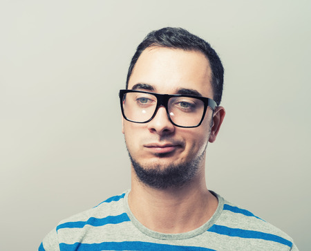 sceptical: Thoughtful sceptical young man Stock Photo