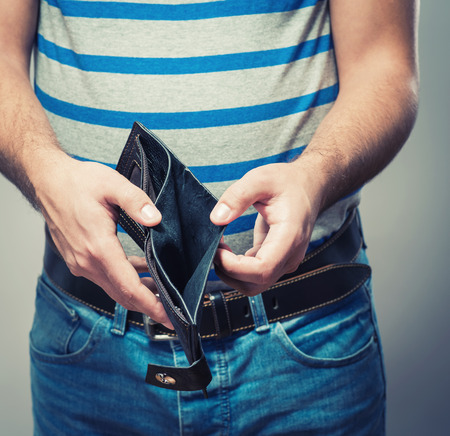 Bankruptcy - Business Person holding an empty wallet photo