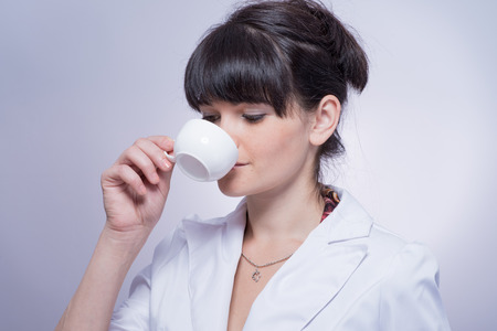 Beautiful Girl Drinking Tea or Coffee. photo
