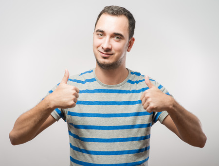 handsome: Handsome man holds his thumbs up Stock Photo