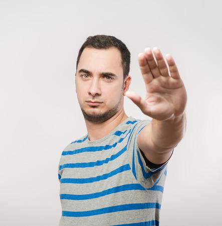 Man showing stop gesture photo