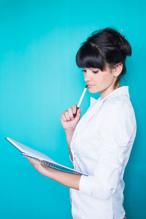 young caucasian  business woman holding diary photo