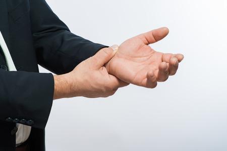 taking pulse: Hand taking pulse Stock Photo