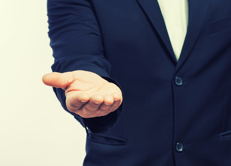 Businessman holding hands out photo
