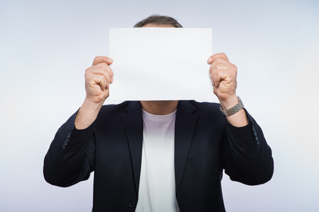 Businessman showing the big blank card in hand photo