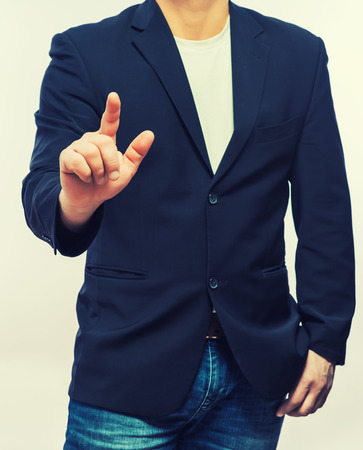 formal: businessman in formal wear pushing forefinger screen Stock Photo