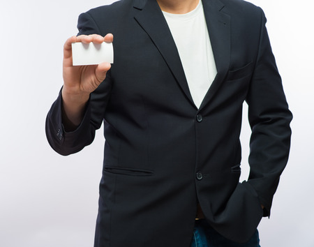 Businessman showing the blank card in hand photo
