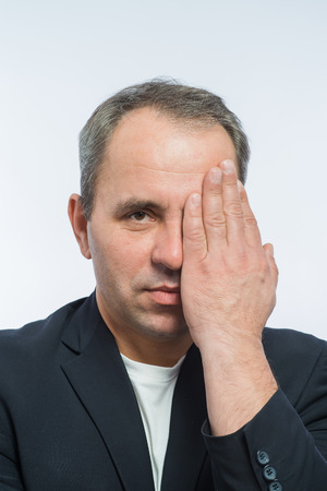 repentance: Businessman covering his face with both hands Stock Photo