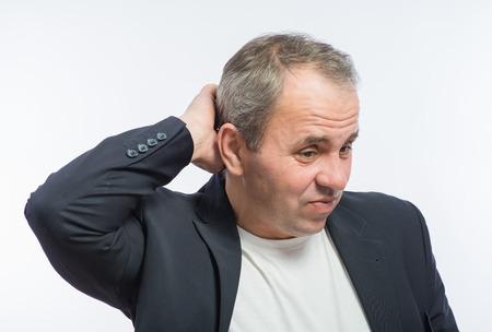 scratches: businessman scratches his head