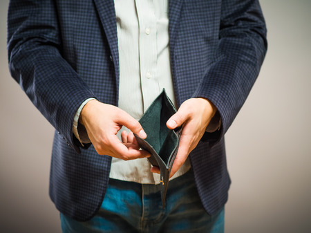 Bankruptcy - Business Person holding an empty wallet Banco de Imagens