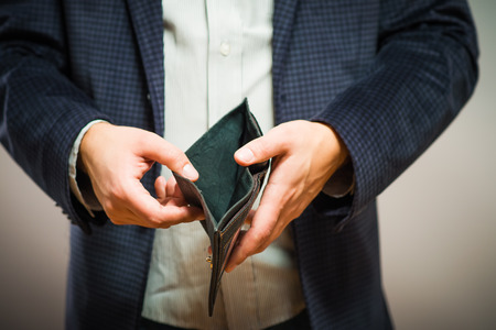 Bankruptcy - Business Person holding an empty wallet Standard-Bild