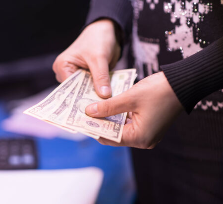 Money in the hand (Hand with money, Hand holding Banknotes) Stock Photo