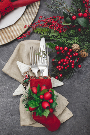 Christmas stocking place settings with festive decorations. Done with vintage retro filter