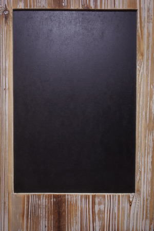 The picture of blank blackboard on wooden frame. Vintage chalkboard blackboard in reclaimed old wooden frame with copy space photo