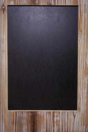 reclaimed: The picture of blank blackboard on wooden frame. Vintage chalkboard blackboard in reclaimed old wooden frame with copy space