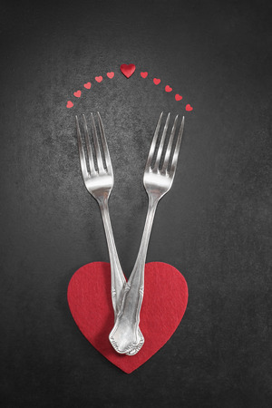 Valentines dinner. Valentines dinner table setting in rustic style with cutlery photo