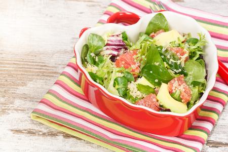 Salad. Spinach and quinoa salad with grapefruit and avocado. Macro, close up photo