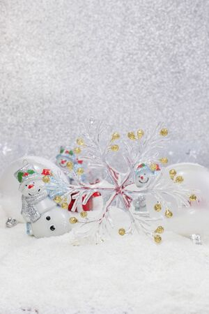 Christmas Card. Cheerful snowman and Christmas tree decorations. Winter background. High key with shallow depth of field photo