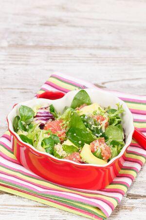 Salad. Spinach and quinoa salad with grapefruit and avocado. Macro, close up. photo