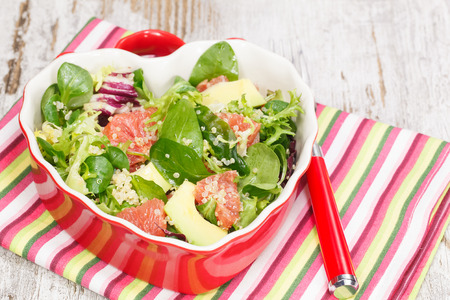 Salad. Quinoa,baby spinach, avocado and grapefruit with a spicy dressing. Macro, close up photo