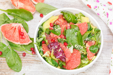 Salad. Fresh salad with grapefruit, avocado and pomegranate seeds. High angle view