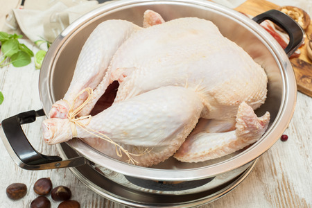 christmas turkey: Fresh raw turkey in a roasting pan ready for the oven. Stock Photo
