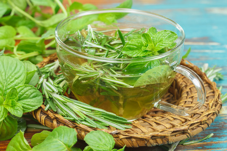 Herbal tea. Rosemary Mint Tea with fresh rosemary and mint leaves. Phytotherapy plants and medical herbs. Macro, selective focus