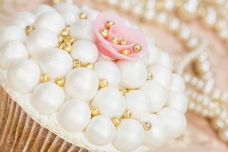 pink pearl: Wedding cupcake with sugar pearls Stock Photo