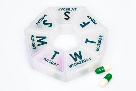 pillbox: Box for medications showing days of the week.
