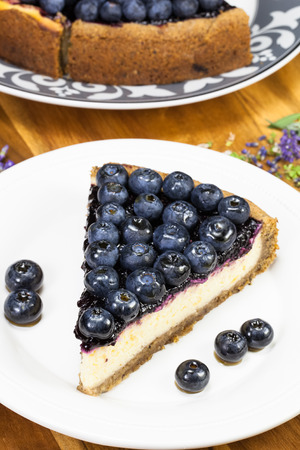 blueberry pie: Blueberry pie. Slice of cake with blueberries close up on a white plate Stock Photo