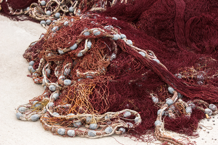 inshore: Pile of fishing nets. left to dry on the beach by inshore fisherman Stock Photo