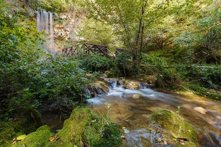 Waterfall down mountain. Beautiful waterfall in forest. Waterfall Lisine or Veliki Buk in Resava court, Despotovac city, Serbia, has height of 25 meters . photo