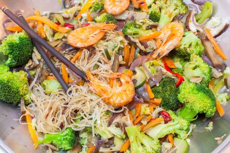 sautee: Wok cooked dish with shrimps and vegetables