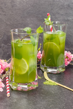 maccha: Matcha Mint Iced Tea.Healthy Iced Matcha Tea with lime, ginger and mint. Macro, selective focus