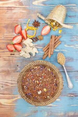 Rooibos Tea. Organic red and green rooibos tea leaves and ingredients