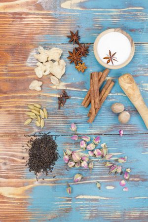 masala chai: Masala chai.  Indian masala chai - spices and igredients on a rustic table