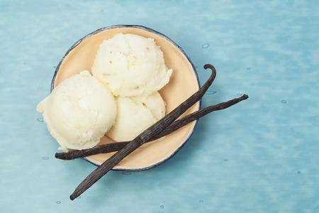 Ice Cream. Vanilla ice cream in rustic bowl on blue table. Top view
