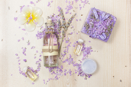 Beauty products with Lavender. Lavender Natural beauty products including lavender soap essential oil bath salt  body butter serum dried flowers  on the wooden board.
