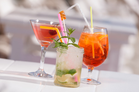 Summer cocktails. Three refreshing summer cocktails at a beach bar. Selective focus