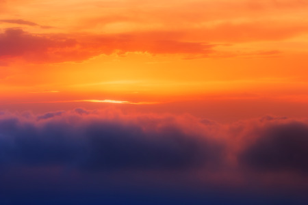orange color: Sunset Clouds Over Sea. Brilliant orange sunset over clouds. Suitable for background