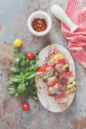 meat skewers: Meat skewers with vegetables in herb and oil marinade,  top view