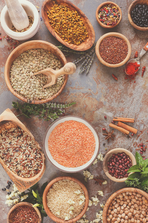 azuki bean: Assortment of legumes, grain and seeds. Various types of grains, rice, legumes spices and herbs  in bowls on rustic table, top view Stock Photo
