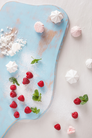 confiserie: Raspberry  meringue kisses. Homemade Raspberry meringue kisses being prepared, top view