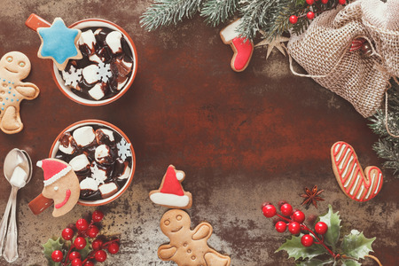 hot: Hot Chocolate with marshmallows and gingerbread cookies in a Christmas setting. Festive decoration. Vintage style with blank space, top view