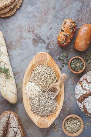 seeds of various: Bread, bread rolls and  grains. Assorted bread, bread rolls and  various seeds for baking. Ingredients for bread preparation, top view, vintage style Stock Photo