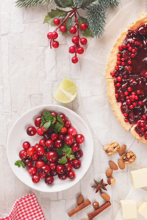 christmas dish: Baking with cranberries, Christmas setting.Vintage style with blank space, top view
