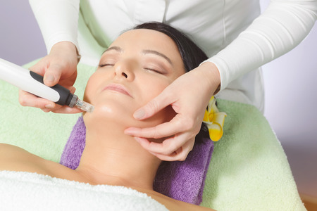 ageing: Mesotherapy, anti ageing treatment. Woman having mesotherapy facial treatment at beauty salon. Stock Photo
