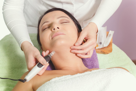 Mesotherapy, anti ageing treatment. Woman having mesotherapy facial treatment at beauty salon. Stock Photo